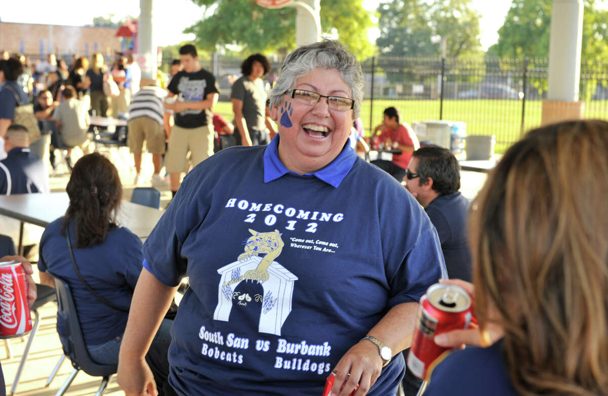 SLUG:SSAN SUPT PROFILE-AssignID 446259-September 22, 2012-San Antonio, Texas---South San Antonio Independent School District Superintendent Rebecca Robinson laughs while talking with Maria Gonzales during a recent Bobcat tailgate party.