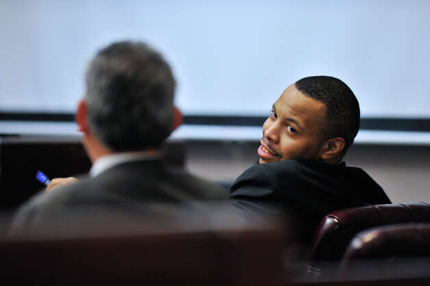 James Morrison, convicted last week of capital murder, talks with his attorney Joel Perez as the sentencing phase of his conviction begins Monday, Oct. 15, 2012. Photo: Robin Jerstad, For The Express-News