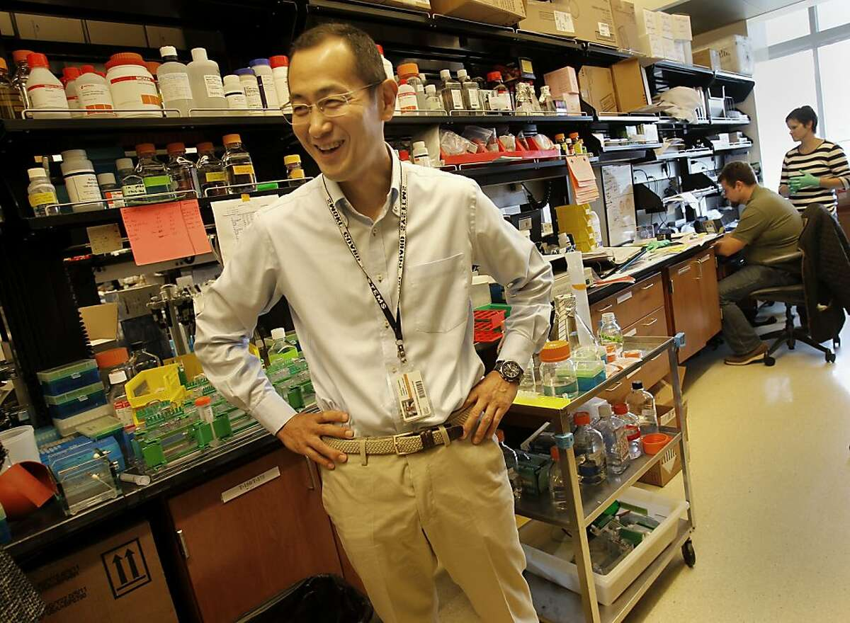 In his Gladstone Institute laboratory, Shinya Yamanaka smiles as he talks with colleagues. Shinya Yamanaka, a scientist who works part-time out of the Gladstone Institute in San Francisco, Calif., is the inventor of IPS (induce pluripotent stem cells) stem cells.