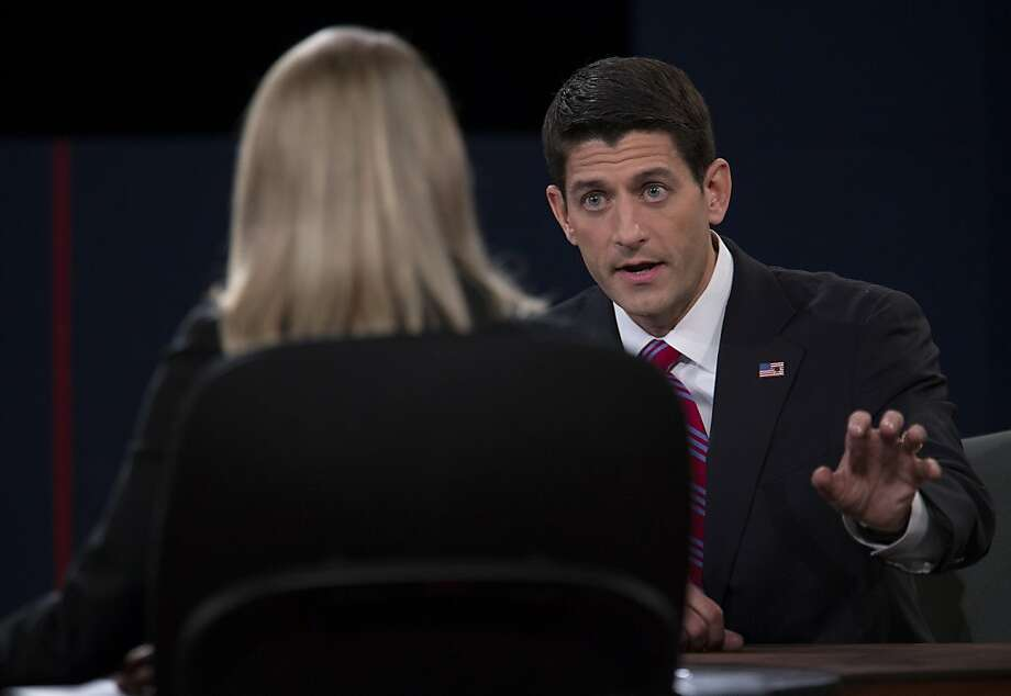 "Representative Paul Ryan, Republican vice presidential candidate, right, speaks during a debate with U.S. Vice President Joseph ""Joe"" Biden, unseen, in front of moderator Martha Raddatz of ABC News in Danville, Kentucky, U.S., on Thursday, Oct. 11, 2012. Ryan said President Barack Obama is presiding over a chaotic foreign policy that is ""unraveling'' and making the US. less safe, as he began his debate tonight with Joe Biden. Photo: Scott Eells, Bloomberg"