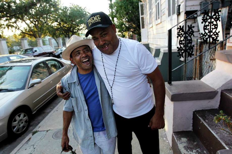 "Drummer Shannon Powell, right, hugs vocalist John Boutte in the Treme section of New Orleans. The historic New Orleans neighborhood where immigrants, free people of color and slaves were allowed to own property, worship on Sundays and gather in public to dance and play music, has hit a milestone. It was roughly 200 years ago that cottages were built and a community established just beyond the French Quarter in the area named for French milliner and property owner, Claude Treme. The neighborhood is considered one of America's most unique, and it is getting a new lease on life thanks, in part, to the spotlight provided by HBO's series, Treme."" It's also at the center of a $4 billion redevelopment plan. (AP Photo/Gerald Herbert) Photo: Gerald Herbert, Associated Press / AP"