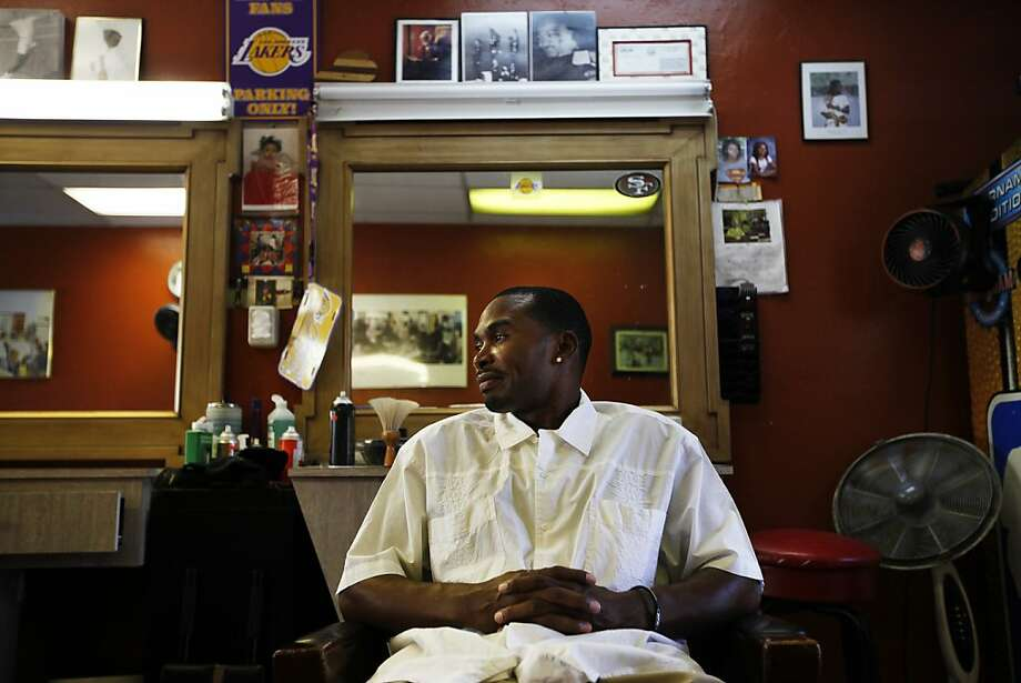 Darnell Thomas, founder of the new magazine What Millionaires Spend Their Money On, hangs out at his local barbershop in San Leandro. Thomas says he had been carrying around the idea for the magazine for a long time. Photo: Sonja Och, The Chronicle