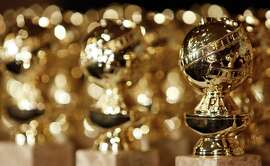 The newly designed Golden Globe statuettes are seen during a news conference at the Beverly Hilton Hotel in Beverly Hills, Calif. on Tuesday, Jan.. 6, 2009.  (AP Photo/Matt Sayles)  statuette award trophy