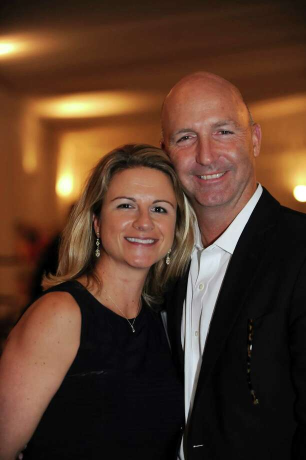 Sue Merz, US Women's Olympic hockey team, gold and silver medalist and Skip Lane, at the Fairfield County Hall of Fame dinner at the Greenwich Hyatt Regency in Greenwich Monday, Oct. 15, 2012. Photo: Helen Neafsey / Greenwich Time