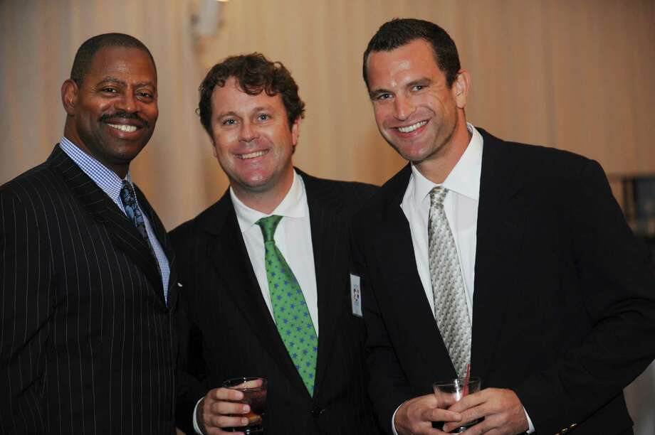 Garry Cobb, a former NFL player, left, Harry Peden and Rad Stroble at the Fairfield County Hall of Fame dinner at the Greenwich Hyatt Regency in Greenwich Monday, Oct. 15, 2012. Photo: Helen Neafsey / Greenwich Time