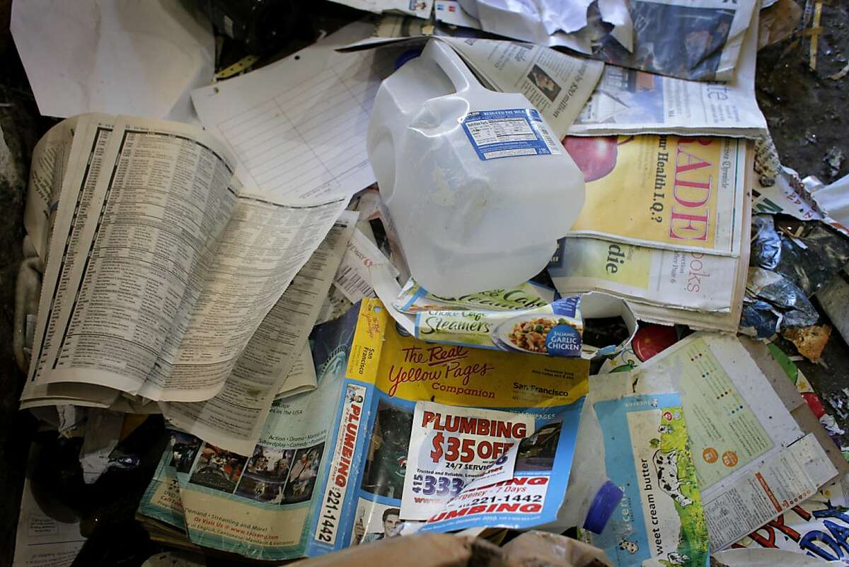 Phonebooks and yellow pages, fall in the outer edges of the recycling, because of their weight, Monday January 31, 2011, at the Recycle Center in San Francisco, Calif.