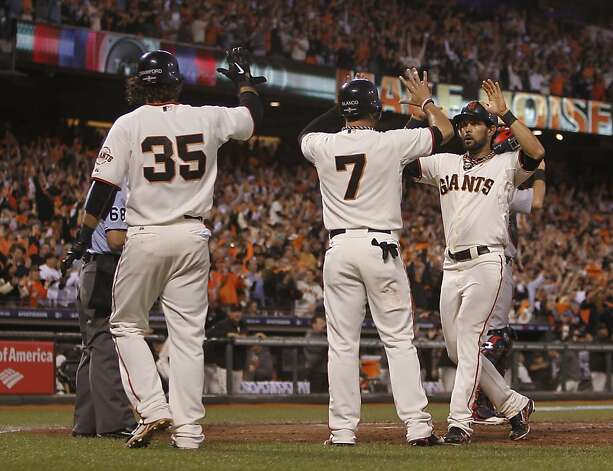 Giants shortstop Brandon Crawford, Gregor Blanco, and Angel Pagan scored in the 4th inning during game 2 of the NLCS at AT&T Park on Monday, Oct. 15, 2012 in San Francisco, Calif. Photo: Michael Macor, The Chronicle