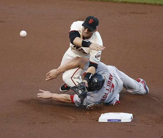 Cardinals left fielder Matt Holliday slides into Giants second baseman Marco Scutaro in the first inning during game 2 of the NLCS on Monday, Oct. 15, 2012 at AT&T Park in San Francisco, Calif. Photo: Beck Diefenbach, Special To The Chronicle