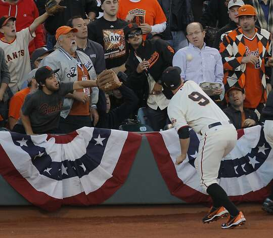 GiantsÕ first baseman Brandon Belt chases down a CardinalsÕ center fielder Jon Jay popup to end the top of the 2nd inning during game 2 of the NLCS at AT&T Park on Monday, Oct. 15, 2012 in San Francisco, Calif. Photo: Carlos Avila Gonzalez, The Chronicle