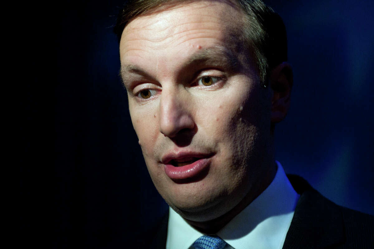 Democratic candidate, U.S. Rep. Chris Murphy, D-Conn., speaks to the media after a debate against Republican candidate Linda McMahon in New London, Conn., Monday, Oct. 15, 2012. (AP Photo/Jessica Hill)
