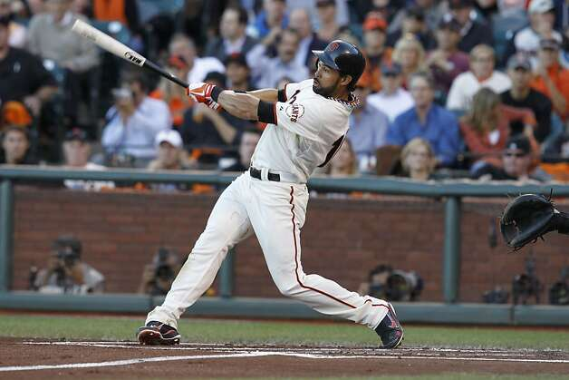 GiantsÕ center fielder Angel Pagan hits a homerun in the first inning during game 2 of the NLCS on Monday, Oct. 15, 2012 at AT&T Park in San Francisco, Calif. Photo: Brant Ward, The Chronicle