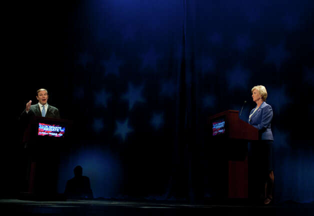 U.S. Rep. Chris Murphy, D-Conn., left, and Republican candidate for U.S. Senate Linda McMahon, right, debate in New London, Conn., Monday, Oct. 15, 2012. The two are vying for the Senate seat now held by Joe Lieberman, an independent who's retiring. (AP Photo/Jessica Hill) Photo: AP