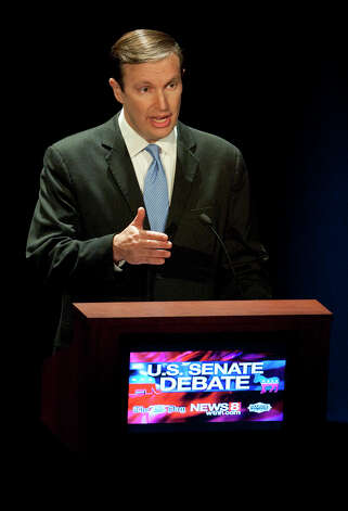 Democratic candidate, U.S. Rep. Chris Murphy, D-Conn., gestures during a debate against Republican candidate for U.S. Senate, Linda McMahon in New London, Conn., Monday, Oct. 15, 2012. The two are vying for the Senate seat now held by Joe Lieberman, an independent who's retiring. (AP Photo/Jessica Hill) Photo: AP