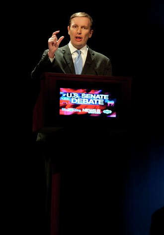 Democratic candidate, U.S. Rep. Chris Murphy, D-Conn., gestures during a debate against Republican candidate for U.S. Senate Linda McMahon in New London, Conn., Monday, Oct. 15, 2012. The two are vying for the Senate seat now held by Joe Lieberman, an independent who's retiring. (AP Photo/Jessica Hill) Photo: AP