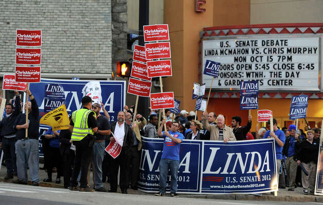 Supporters of Republican Linda McMahon, and U.S. Rep. Chris Murphy, D-Conn., gather prior to a candidate's debate for an open U.S. Senate seat in New London, Conn., Monday, Oct. 15, 2012. (AP Photo/Jessica Hill) Photo: AP