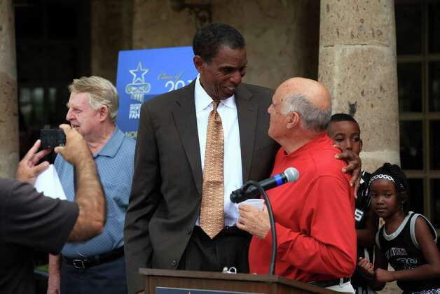Former Spur Larry Kenon, center, talks with former UTSA Athletic Director Rudy Davalos during the announcement ceremony for the San Antonio Sports Hall of Fame Class of 2013 at The Dominion Country Club on Monday, Oct. 15, 2012.  Also in the class are golfer Joe Conrad, pictured at left, Ed Whitacre, former CEO of General Motors and AT&T, and former MLB pitcher Norm Charlton.  In back at right are Kenon's grandchildren, Jordan Mason, 8, and Tatum Mason, 5. Photo: Bob Owen, Express-News / © 2012 San Antonio Express-News