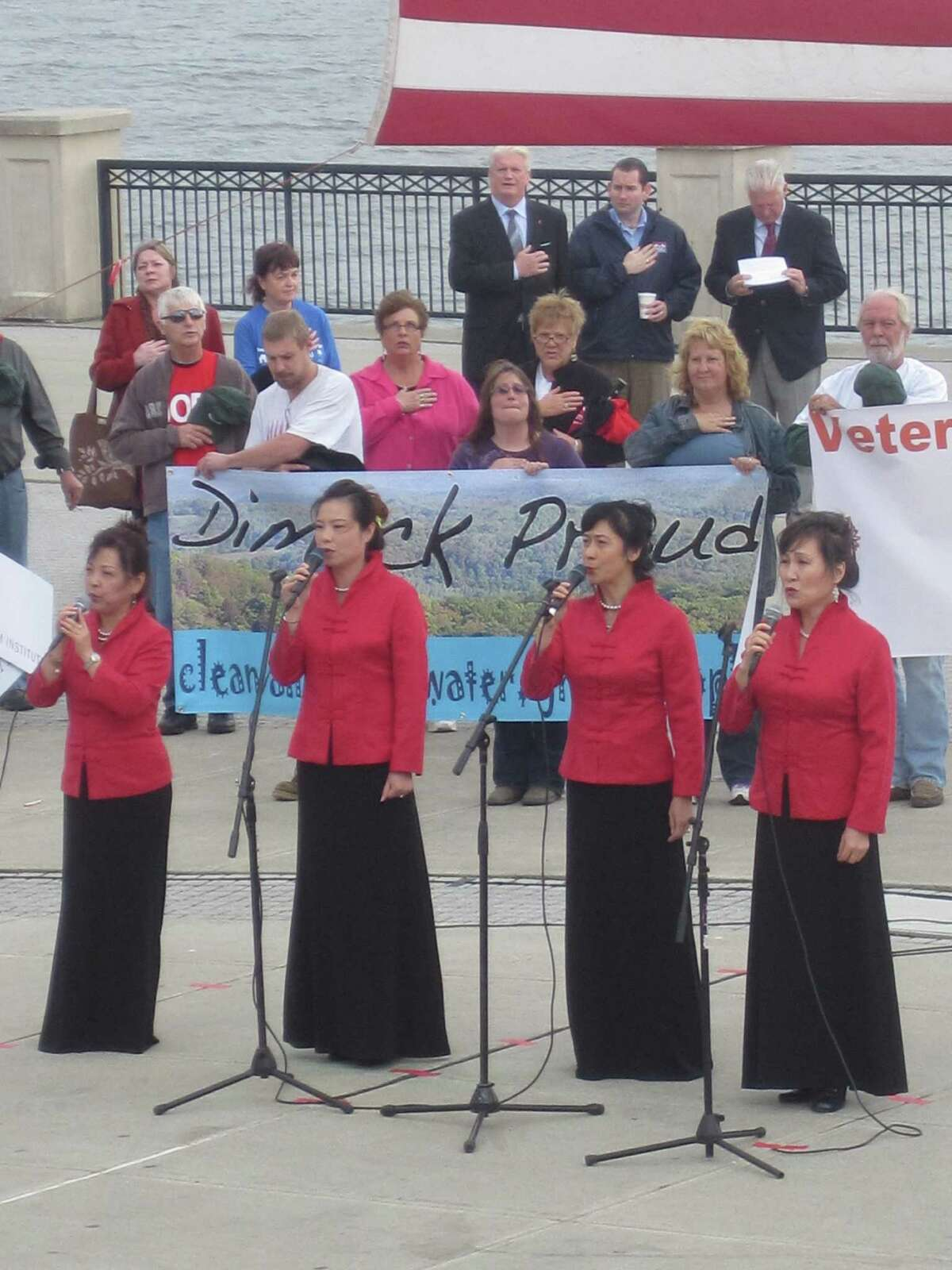 Members of the Long Island Chinese Choir sang the national anthem at a pro-frack rally at Albany's Corning Preserve on Monday. (Times Union / Alysia Santo)