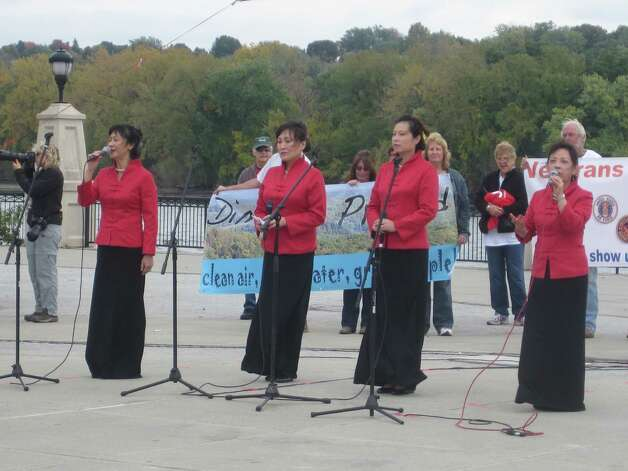 "Members of the Long Island Chinese Choir sang ""Amazing Grace"" at a pro-frack rally at the Albany Corning Preserve on Monday.  (Times Union / Alysia Santo)"