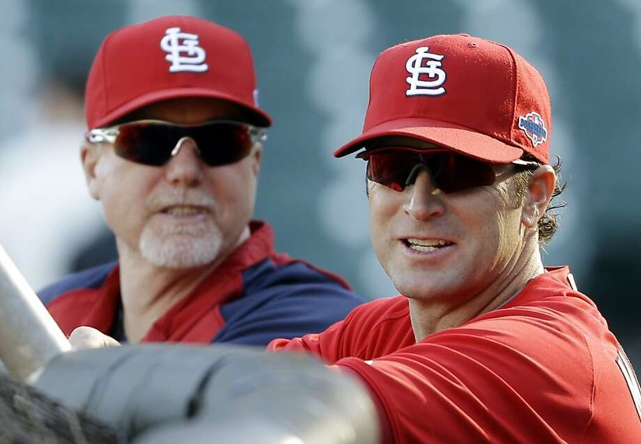Cardinals hitting coach Mark McGwire (left, with St. Louis manager Mike Matheny) gave his Bay Area fans some love before Game 2. Photo: Eric Risberg, Associated Press
