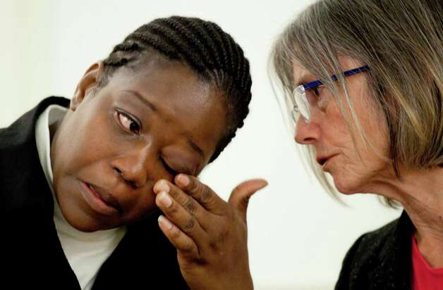 Rubbie McCoy, left, a plaintiff in a lawsuit filed against Morgan Stanley, reacts while describing her housing situation during a news conference, Monday, Oct. 15, 2012 in New York. With her is attorney Elizabeth Cabraser. McCoy and four other Detroit homeowners are represented by the American Civil Liberties Union, the ACLU of Michigan, The National Consumer Law Center, and a law firm. The suit claims that Morgan Stanley discriminated against black homeowners and violated federal civil rights laws. (AP Photo/Mark Lennihan) Photo: Mark Lennihan