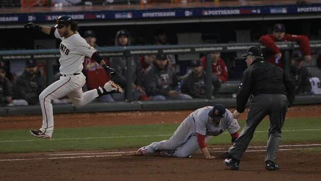 Brandon Crawford is safe on Chris Carpenter's error in the fourth inning, when the Giants broke through with four runs. Photo: Carlos Avila Gonzalez, The Chronicle