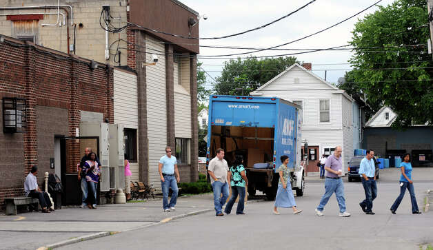 Employees walk out  of the Contec Company at 1023 State Street in Schenectady where 132 workers were given layoff notices according to Contec Holdings, Ltd. COO Carroll W. Foreman Jr. July 24, 2009.   (Skip Dickstein / Times Union) Photo: SKIP DICKSTEIN