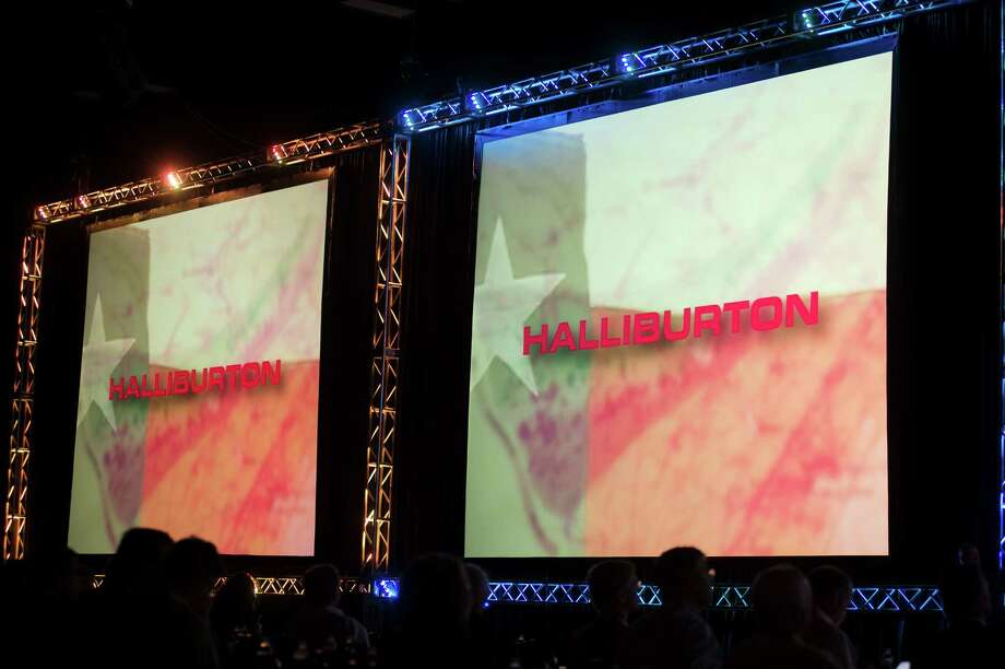 Halliburton Co. signage is displayed at the DUG Eagle Ford Conference & Exhibition in San Antonio, Texas, U.S., on Monday, Oct. 15, 2012. Marathon Oil Corp., the U.S. oil and natural gas producer that spun off its refining business last year, is seeking to sell more than 96,000 net acres in the Eagle Ford formation in Texas. Photographer: Eddie Seal/Bloomberg Photo: Eddie Seal / © 2012 Bloomberg Finance LP