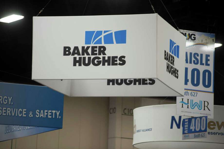 Baker Hughes Inc. signage is displayed at the DUG Eagle Ford Conference & Exhibition in San Antonio, Texas, U.S., on Monday, Oct. 15, 2012. Marathon Oil Corp., the U.S. oil and natural gas producer that spun off its refining business last year, is seeking to sell more than 96,000 net acres in the Eagle Ford formation in Texas. Photographer: Eddie Seal/Bloomberg Photo: Eddie Seal / © 2012 Bloomberg Finance LP