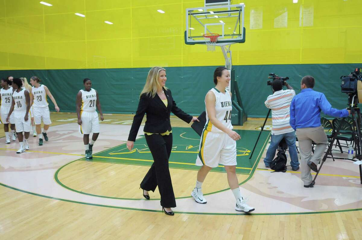 Head Coach Ali Jaques, center, talks with player Kelsy Booth as they and the rest of the tema walk for for the start of the Siena women's basketball media day at the Alumni Recreation Center on the Siena Campus on Monday, Oct. 15, 2012 in Loudonville, NY. (Paul Buckowski / Times Union)