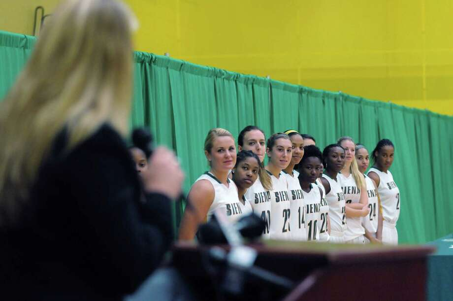 Head Coach Ali Jaques, foreground, talks about her players, background, as they look on  during Siena women's basketball media day at the  Alumni Recreation Center on the Siena Campus on Monday, Oct. 15, 2012 in Loudonville, NY.    (Paul Buckowski / Times Union) Photo: Paul Buckowski