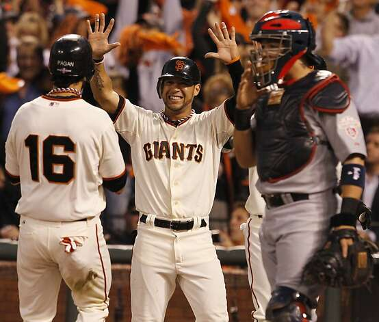 Giants' left fielder Gregor Blanco greets Angel Pagan at the plate in the 4th inning during game 2 of the NLCS on Monday, Oct. 15, 2012 at AT&T Park in San Francisco, Calif. Photo: Brant Ward, The Chronicle