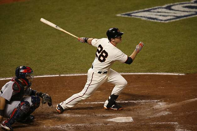 Giants' catcher Buster Posey singles to start off the 5th inning during game 2 of the NLCS on Monday, Oct. 15, 2012 at AT&T Park in San Francisco, Calif. Photo: Beck Diefenbach, Special To The Chronicle