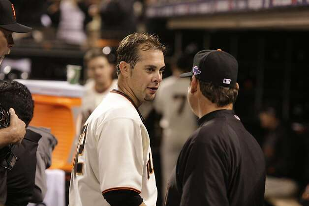 Giants' pitcher Ryan Vogelsong takes a break between innings during game 2 of the NLCS on Monday, Oct. 15, 2012 at AT&T Park in San Francisco, Calif. Photo: Brant Ward, The Chronicle