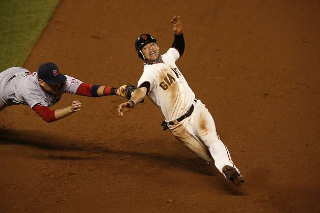 Giants' left fielder Gregor Blanco is called safe at 1st base in the 8th inning during game 2 of the NLCS on Monday, Oct. 15, 2012 at AT&T Park in San Francisco, Calif. Photo: Beck Diefenbach, Special To The Chronicle