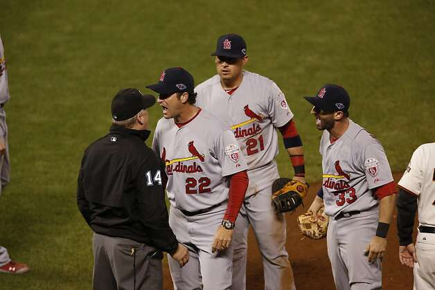 Cardinals' manager Mike Matheny, Allen Craig, and Daniel Descalso argue with first base umpire Bill Miller in the 8th inning during game 2 of the NLCS on Monday, Oct. 15, 2012 at AT&T Park in San Francisco, Calif.  Miller called Gregor Blanco safe. Photo: Beck Diefenbach, Special To The Chronicle