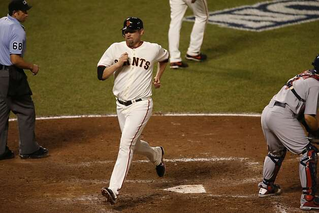 Giants' first baseman Aubrey Huff scores in the 8th inning during game 2 of the NLCS on Monday, Oct. 15, 2012 at AT&T Park in San Francisco, Calif. Photo: Beck Diefenbach, Special To The Chronicle