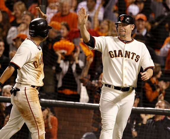 Gregor Blanco (left) and Aubrey Huff celebrated their scoring in the 8th inning. The San Francisco Giants defeated the St. Louis Cardinals 7-1 Monday October 15, 2012 at AT&T park in the second game of the League Championship. Photo: Brant Ward, The Chronicle