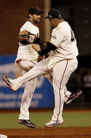 Angel Pagan (left) and Pablo Sandoval celebrated the end of the game. The San Francisco Giants defeated the St. Louis Cardinals 7-1 Monday October 15, 2012 at AT&T park in the second game of the League Championship. Photo: Brant Ward, The Chronicle
