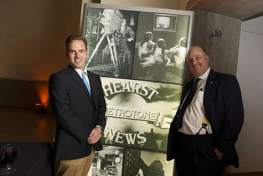 Will Hearst, left, and his father, William Randolph Hearst III, right, pose in front of a Hearst News photo collage at the Legion of Honor in San Francisco during a reception before a screening of Citizen Hearst, a new documentary about William Randolph Hearst on Monday, October 15, 2012. Photo: Erin Lubin, Special To The Chronicle