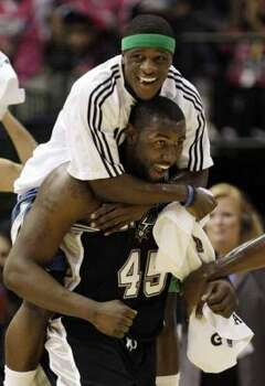 Minnesota Timberwolves Jonny Flynn celebrates with San Antonio Spurs' DeJuan Blair (45) after the rookies beat the Sophomores 140-128 in the Rookie Challenge game during the NBA basketball All-Star Weekend Friday, Feb. 12, 2010, in Dallas. (AP Photo/LM Otero) (LM Otero / AP)