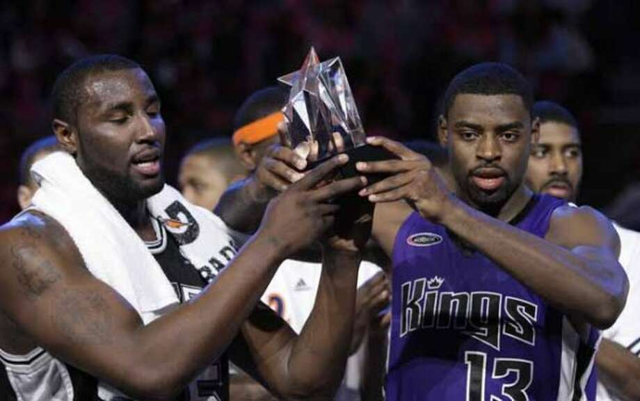 Rookie Challenge game MVP Sacramento Kings guard Tyreke Evans, right, holds up the trophy with San Antonio Spurs forward DeJuan Blair during the NBA basketball All-Star Weekend Friday, Feb. 12, 2010, in Dallas. The rookies beat the sophomores 140-128. (AP Photo/LM Otero) (LM Otero / AP)