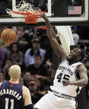 San Antonio Spurs' DeJuan Blair, right, dunks over Cleveland Cavaliers' Zydrunas Ilgauskas, of Lithuania, during the second half of an NBA basketball game in San Antonio, Friday, March 26, 2010. San Antonio won 102-97. (AP Photo/Darren Abate) (Darren Abate / AP)