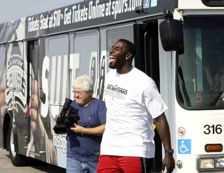 METRO: Spurs forward DeJuan Blair reacts after taking his turn driving the new Spurs wrapped VIA bus.  Blair and guard George Hill competed in a timed obstacle course to see who was the best driver.  Hill won the competition.  HELEN L. MONTOYA/hmontoya@express-news.net (HELEN L. MONTOYA / SAN ANTONIO EXPRESS-NEWS)