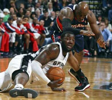 FOR SPORTS - Spurs' DeJuan Blair grabs for a loose ball under Hawks' Damien Wilkins during first half action Friday Dec. 10, 2010 at the AT&T Center. (PHOTO BY EDWARD A. ORNELAS/eaornelas@express-news.net) (EDWARD A. ORNELAS / SAN ANTONIO EXPRESS-NEWS)