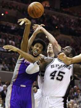 FOR SPORTS - Spurs' Matt Bonner and teammate Spurs' DeJuan Blair grab for the ball against Suns' Josh Childress during first half action Monday Dec. 20, 2010 at the AT&T Center. (PHOTO BY EDWARD A. ORNELAS/eaornelas@express-news.net) (EDWARD A. ORNELAS / SAN ANTONIO EXPRESS-NEWS)