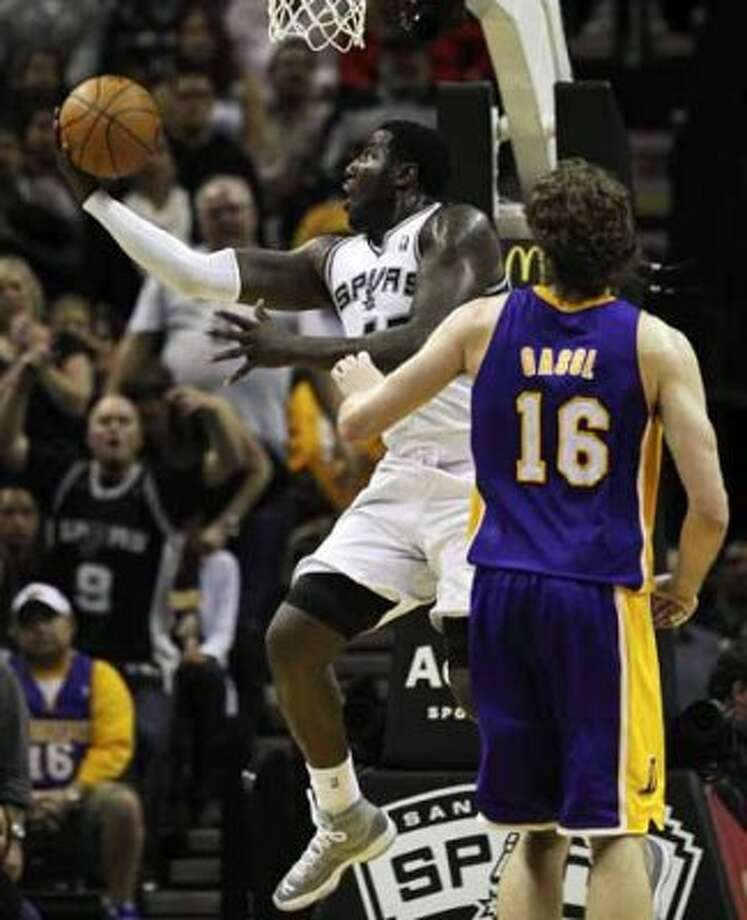 Spurs' DeJuan Blair (45) drives past Los Angeles Lakers' Pau Gasol (16) to score in the second half at the AT&T Center on Tuesday, Dec. 28, 2010.  Spurs defeated the Lakers 97-82. Kin Man Hui/kmhui@express-news.net (KIN MAN HUI / SAN ANTONIO EXPRESS-NEWS)