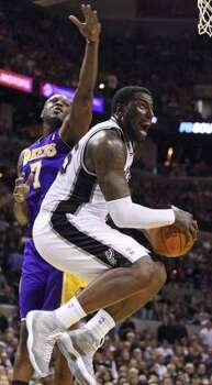 FOR SPORTS - Spurs' DeJuan Blair shoots around Lakers' Lamar Odom during second half action Tuesday Dec. 28, 2010 at the AT&T Center. The Spurs won 97-82. (PHOTO BY EDWARD A. ORNELAS/eaornelas@express-news.net) (EDWARD A. ORNELAS / SAN ANTONIO EXPRESS-NEWS)