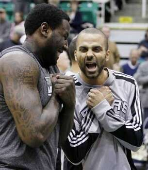 Spurs forward DeJuan Blair, left, and guard Tony Parker of France, right, joke before an NBA basketball game against the Jazz in Salt Lake City, Wednesday Jan. 26, 2011. (AP Photo/Colin E Braley) (Colin E Braley / AP)