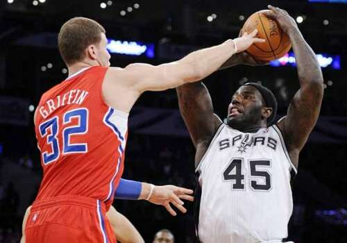 Rookie Blake Griffin, left, of the Los Angeles Clippers, guards sophomore DeJuan Blair, of the San Antonio Spurs,  during the first half of the Rookie Challenge game during the NBA basketball All-Star Weekend, Friday, Feb. 18, 2011, in Los Angeles.  (AP Photo/Mark J. Terrill) (Mark J. Terrill / AP)