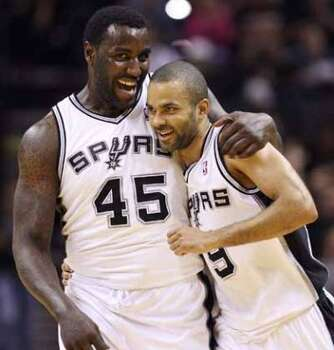 FOR SPORTS - Spurs' DeJuan Blair hugs teammate Tony Parker after Parker scored a three pointer against the Kings during second half action Friday March 11, 2011 at the AT&T Center. The Spurs won 108-103.  (PHOTO BY EDWARD A. ORNELAS/eaornelas@express-news.net) (EDWARD A. ORNELAS / SAN ANTONIO EXPRESS-NEWS)